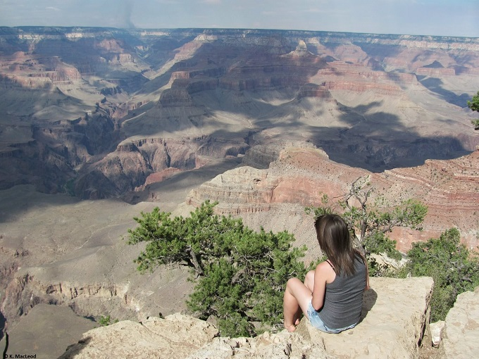 Sitting at the edge of the Grand Canyon