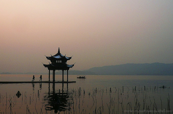 Running by Hangzhou's West Lake at sunset