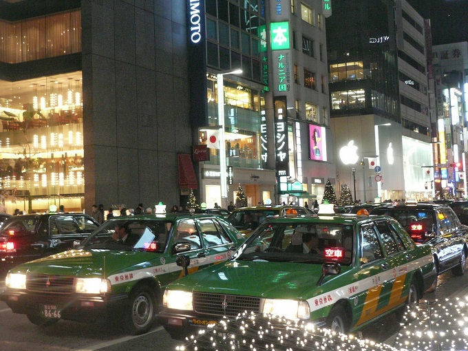 Taxis in traffic at Ginza, Tokyo