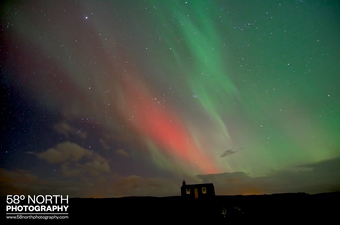 Old house illuminated by the Norther Lights, Isle of Lewis