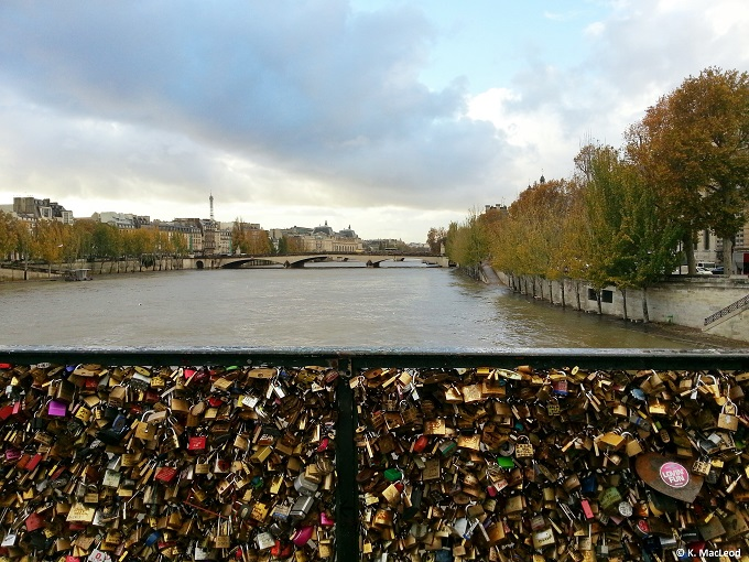 Love locks & the Eiffel Tower in the distance