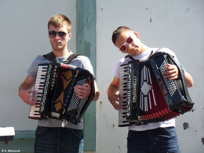 Street busking with accordians in Stornoway