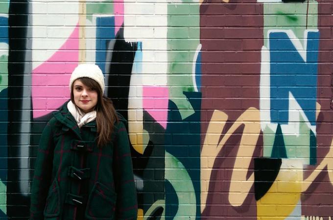 Portrait in front of street art in Soho, NYC