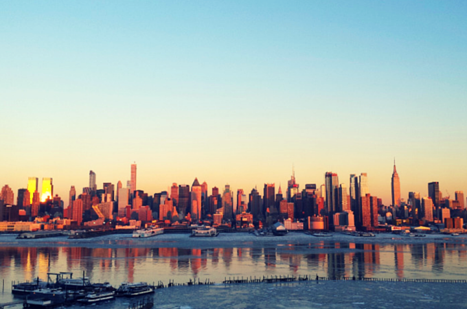 New York City skyline illuminated at sunset