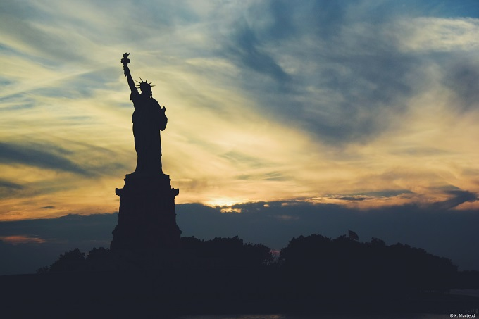 Statue of Liberty outlined at sunset