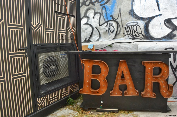 Pop-up bar in front of street art in New York City