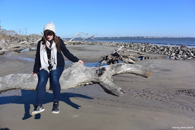Sitting on a log at Driftwood Beach