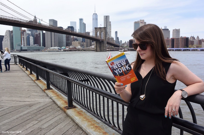 Reading a guidebook in NYC